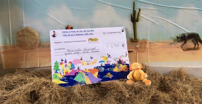 Merci à tous les enfants, parents, visiteurs et toute l'équipe de la crèche Sim Sala Bim pour ce magnifique chèque.